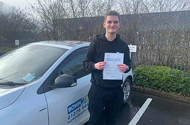 Driving student driving test success - Student test passed - Standing in front of driving school vehicle and displaying certificate