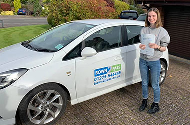 Driving pupil driving test success - Student test passed - Standing in front of driving school vehicle and displaying certificate - Student test passed - Standing in front of driving school vehicle and displaying certificate