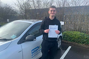 Student Test Passed - Standing In Front Of Driving School Vehicle And Displaying Certificate